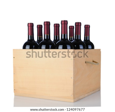 Cabernet Sauvignon wine bottles in a wooden crate. Vertical format isolated on white with reflection. - stock photo