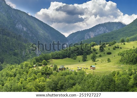 cabin in the mountains summer cloudy sky tree green nature - stock photo