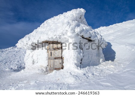 Cabin in the snow. - stock photo