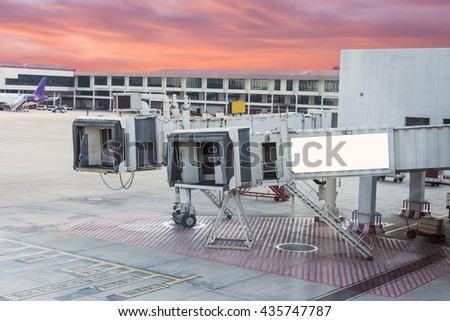 Cabin of plane with gate way passengers arrive on airport - stock photo