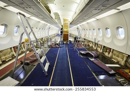 Cabin of the airplane under heavy maintenance - stock photo