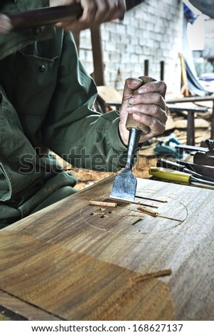 Cabinetmaker chisel to carve  - stock photo