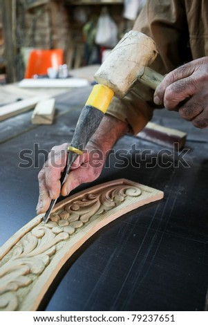 Cabinetmaker chisel to carve a single block of wood - stock photo