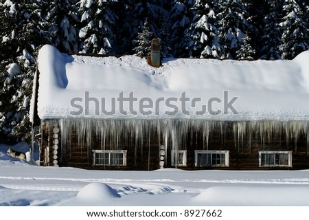 Cabins buried in central Idaho winter - stock photo