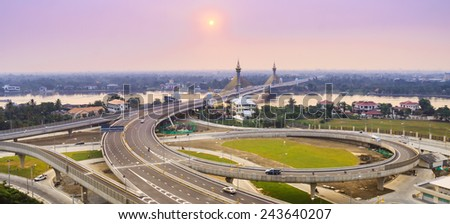 cable bridge and road street with sunset - stock photo