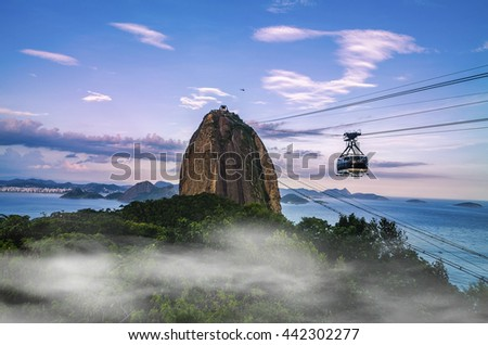 Cable car and Sugar Loaf mountain at sunrise with fog, Rio de Janeiro - stock photo