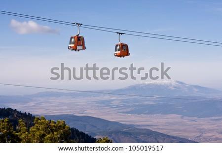 Cable car ski lift over mountain landscape. Rila mountains, ski resort Borovets, Bulgaria - stock photo