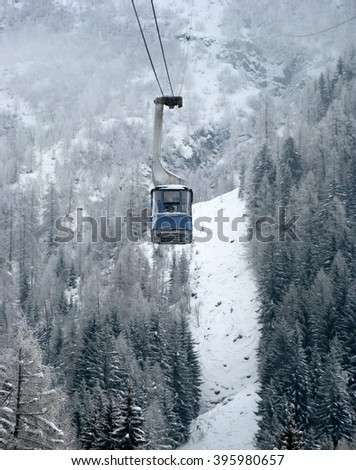 Cable lift from Chamonix to the summit of the Aiguille du Midi  and mountains panorama Mont Blanc and Chamonix view. France. - stock photo