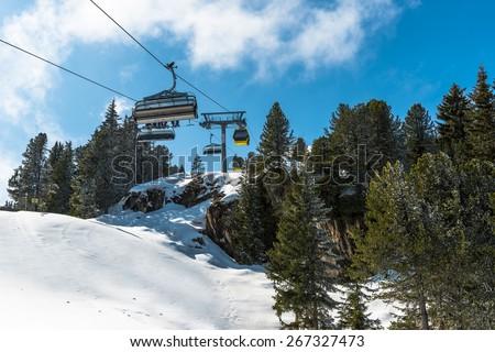 Cable ski  lifts in Mayrhofen ski resort on Penken peak - Zillertal region, Austria - stock photo
