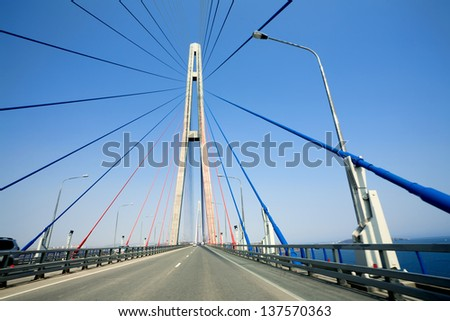 cable-stayed bridge to Russian Island. Vladivostok. Russia. Vladivostok is the largest port on Russia's Pacific coast and the center of APEC Forum 2012. - stock photo