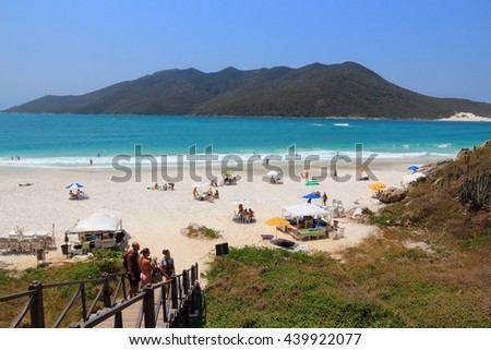 CABO FRIO, BRAZIL - OCTOBER 17, 2014: People visit Cabo Frio Prainhas beach in state of Rio de Janeiro in Brazil. Brazil had 5.17 million visitors in 2012. - stock photo