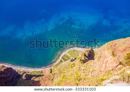 Cabo Girao on the Island Madeira - a sight with spectacular view from a glass platform to the atlantic ocean and terraced fields - stock photo