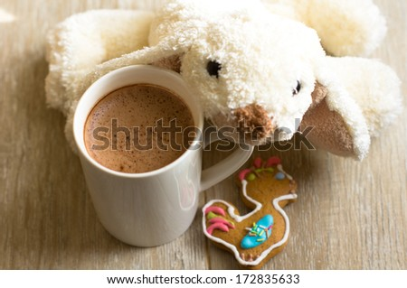 Cacao drink in the mug and old teddy bear toy - stock photo