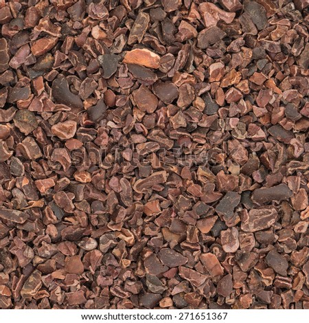 Cacao nibs, overhead view for texture or background - stock photo