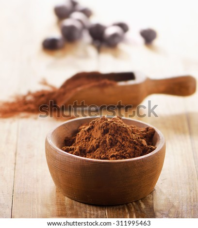 Cacao powder in  a bowl. Selective focus - stock photo