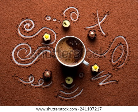 Cacao powder with candy - stock photo