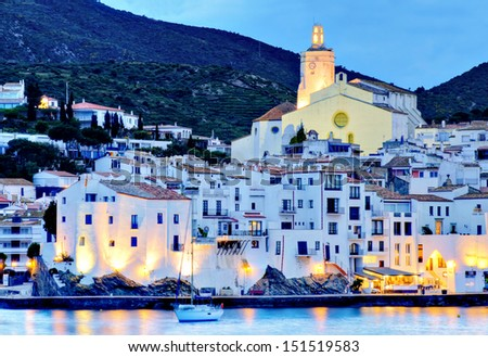 Cadaqeus, Costa brava, Spain: cathedral and Old Town with sailing boat.  - stock photo