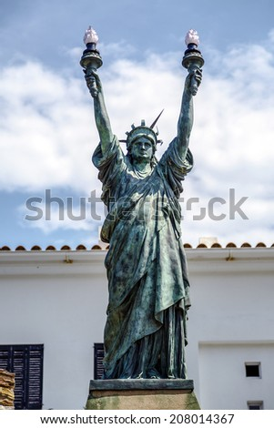CADAQUES, SPAIN - JULY 27, 2014: Freedom, bronze. Dali sculpture inspired by the artist Bartholdi 1994. Captain Moore gift to the town of Cadaques. - stock photo