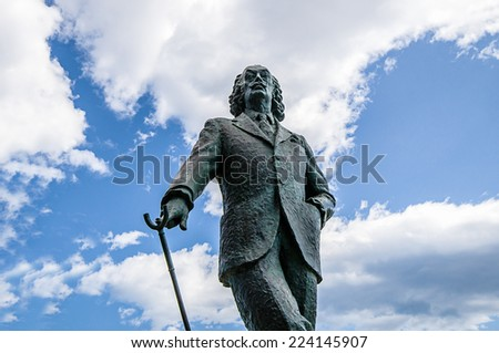 CADAQUES, SPAIN - JULY 21: View of Cadaques, one of the most touristic villages of Costa Brava, on July 21, 2014, in Port de la Selva, Catalonia, Spain. View of Salvador Dali statue. - stock photo