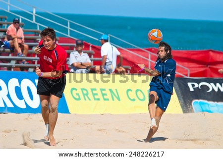 CADIZ, SPAIN -  JUL 30:  Unknown players of the team of Cadiz and Gijon playing the Spanish Championship of Beach Soccer on Jul 30, 2005 on the beach of La Victoria in Cadiz, Spain - stock photo
