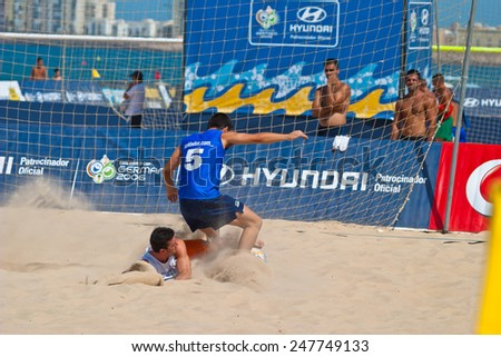 CADIZ, SPAIN -  JUL 22:  Unknown players of unknown team playing the Spanish Championship of Beach Soccer on Jul 22, 2006 on the beach of La Victoria in Cadiz, Spain - stock photo