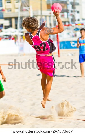 CADIZ, SPAIN - JULY 19: Unidentified players compete in a match between Autoescuela Barquin and CadizSur Seguros BMPY in the 19th league of beach handball of Cadiz on July 19, 2011 in Cadiz, Spain - stock photo