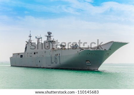 CADIZ, SPAIN-JUN 01: Aircraft carrier L-61 Juan Carlos I docking to take part in an exhibition on the day of the spanish army forces on Jun 01, 2012, in Cadiz, Spain - stock photo