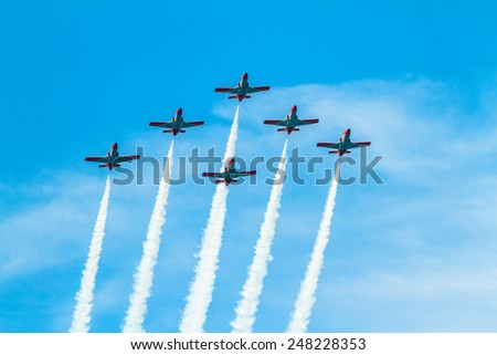 CADIZ, SPAIN-SEP 9: Aircrafts of the Patrulla Aguila taking part in a test on the 4th airshow of Cadiz on Sep 9, 2011, in Cadiz, Spain - stock photo