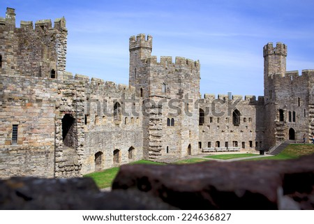 CAERNARVON, WALES, UK - September16, 2014: Caernarvon castle where in 1969 the investiture of the current Prince of Wales HRH Prince Charles took place. - stock photo