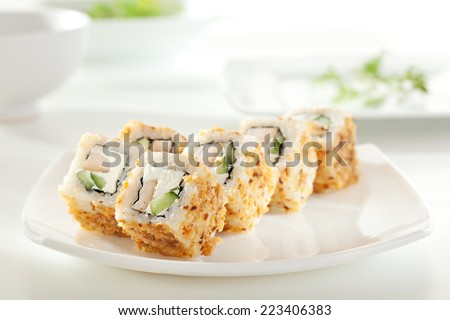 Caesar Maki Sushi - Roll made of Smoked Chicken Breast, Cheese and Cucumber inside. Croutons outside - stock photo