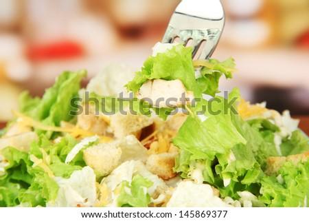 Caesar salad, close up, on bright background - stock photo