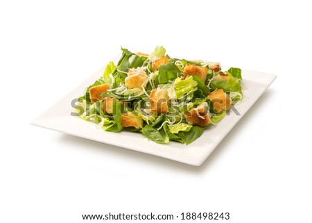Caesar salad in a white plate - stock photo