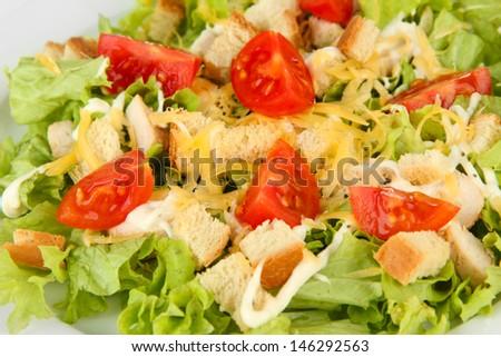 Caesar salad on white plate, close up - stock photo