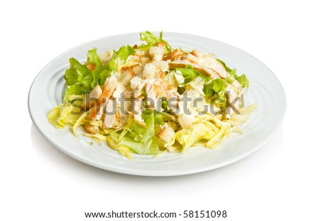 Caesar salad with chicken and croutons.  Isolated on white by clipping path - stock photo