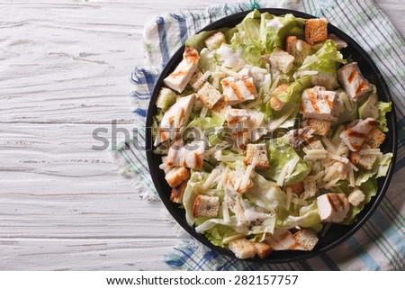 Caesar salad with chicken closeup on the plate. horizontal view from above  - stock photo