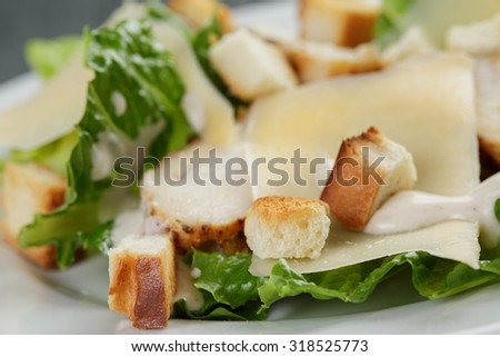 Caesar salad with chicken on wooden table, shallow focus - stock photo