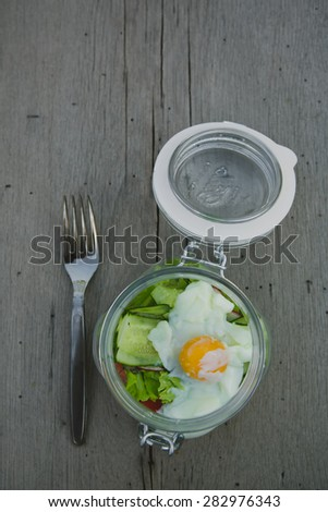Caesar salad with eggs, cherry tomatoes and grilled chicken - stock photo