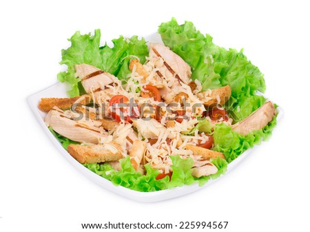 Caesar salad with parmesan. Isolated on a white background. - stock photo