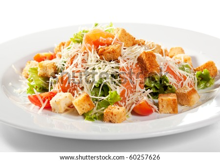 Caesar Salad with Salmon. Comprises Romaine Salad Leaf and Croutons Dressed with Parmesan Cheese - stock photo