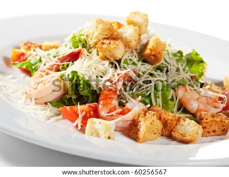 Caesar Salad with Seafood. Comprises Romaine Salad Leaf and Croutons Dressed with Parmesan Cheese - stock photo