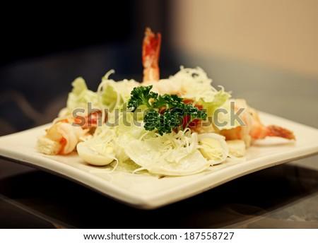 Caesar salad with shrimp - stock photo