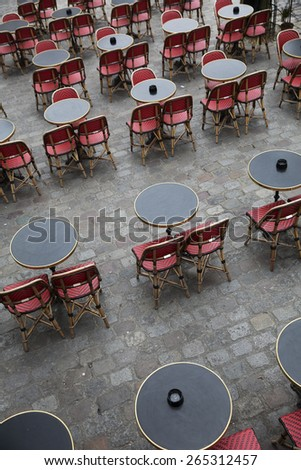 Cafe in Paris with no people from high angle view - stock photo