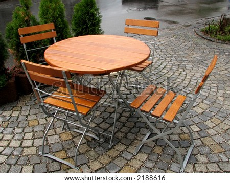Cafe in the street after a rain. - stock photo