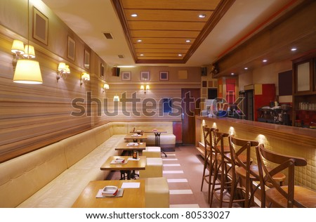 Cafe interior with wooden furniture, lighting equipment and decoration. - stock photo