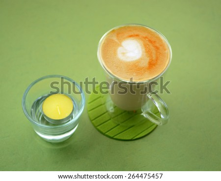 Cafe latte on green background  - stock photo