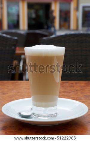cafe macciato in a sidewalk cafe - stock photo