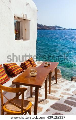 Cafe near the sea at Little Venice on Mykonos Island. Greece. - stock photo