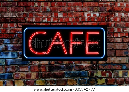 Cafe Neon Sign on a grunge brick wall - stock photo