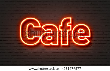 Cafe neon sign on brick wall background - stock photo