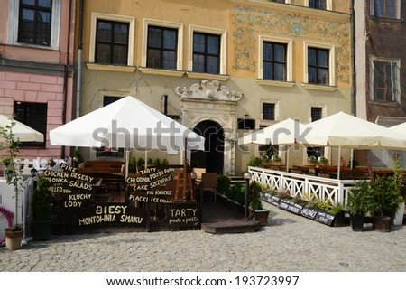 cafe on the square of the old city - stock photo